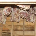 Cured hams in the smokehouse