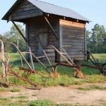 Farm Smoke House and plows
